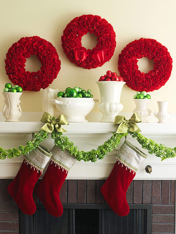 red-carnation-wreaths-above-mantel-Better-Homes-Gardens